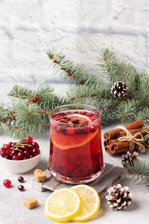 Cranberry juice with lemon and cane sugar. Winter hot drink