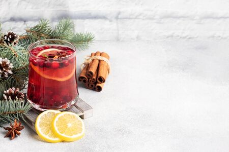 Cranberry juice with lemon and cane sugar. Winter hot drink Copy space