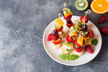 Fresh fruit on skewers. Concept buffet for a summer party Copy space