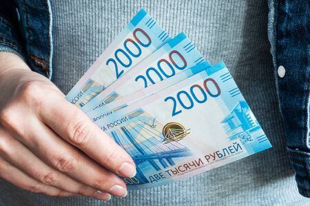 Women's hands take money rubles out of their wallets