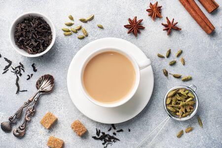 Indian drink masala tea with milk and spices. Cardamom sticks cinnamon star anise cane sugar. Reklamní fotografie