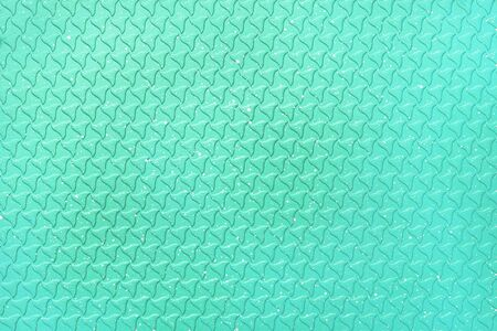 Bright abstract turquoise color background. The texture of the surface of the grill pan. 免版税图像