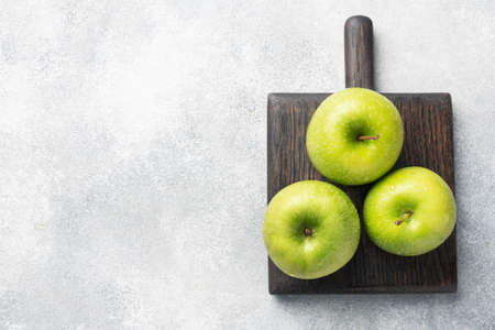 Ripe green apples on a gray concrete background. copy space