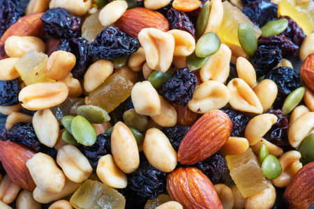 Close up mixture of nuts and dried fruits. Concept of healthy food 免版税图像