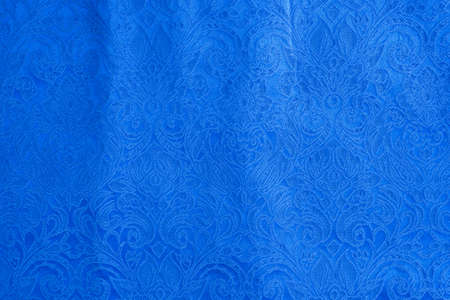 Background is made of blue textile material abstract tapestry drawing, the texture of a piece of clothing