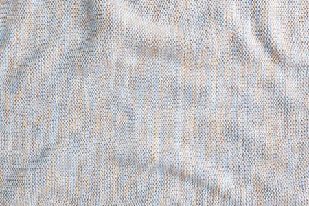 Texture beige knitted wool, background textile material. Close up 免版税图像