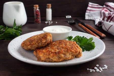 Buckwheat cutlets with cheese and parsley on a plate Healthy diet food