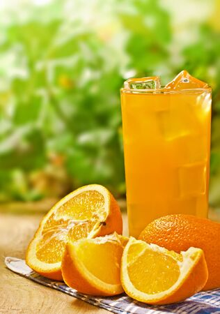 Orange juice on the wood surface, outdoor photo