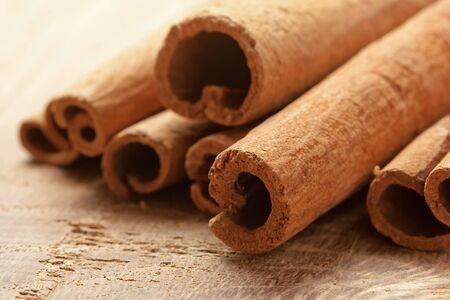 cinnamon bark: Cinnamon bark on the wooden surface Stock Photo
