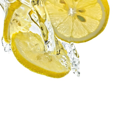 Lemon slices in water splash isolated on white photo