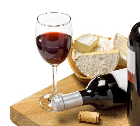 Red wine, Brie and Camembert  on the wood surface, studio shot, isolated, white background photo