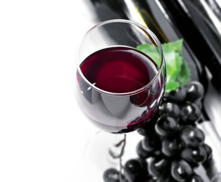 Red wine and grape, isolated, wihite background photo