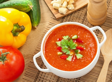 Gazpacho and ingredients on a table, vegetable soup Stock Photo