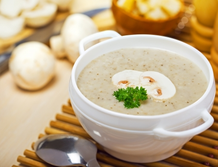 Mushroom cream soup on a table, food photo