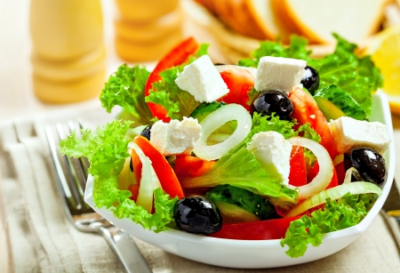 Greek vegetable salad with feta cheese, top view photo