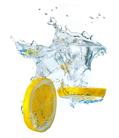 Lemon slices and ice cubes splashing water, isolated on white background photo