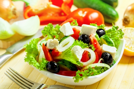 salad fork: Greek vegetable salad with feta cheese Stock Photo