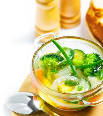 Vegetable soup on white background photo