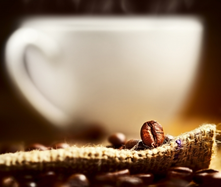 Coffee beans and cup on background photo