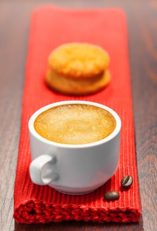 Coffee cup and cookies on a table photo