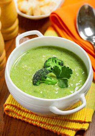 Broccoli cream soup on a table photo