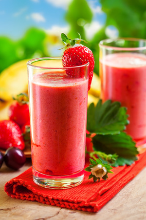 Summer drink, strawberry smoothies, outdoor photo