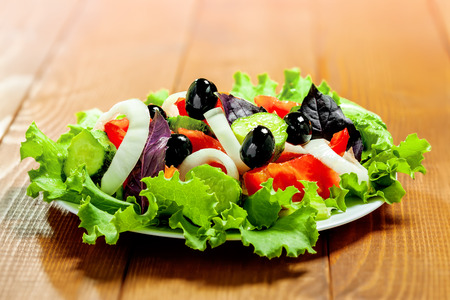 Fresh vegetable salad on table