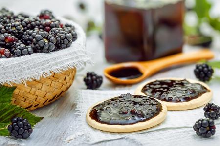 wooden basket: Blackberry jam on cookies