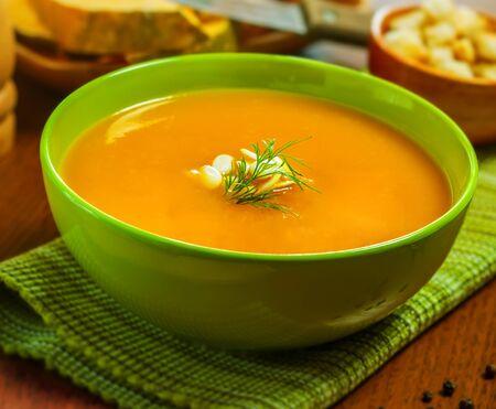 pumpkin soup: Pumpkin Soup with croutons on table