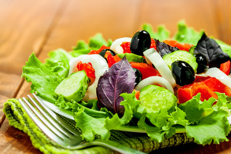 Salad on table, vegetarian healthy food Imagens