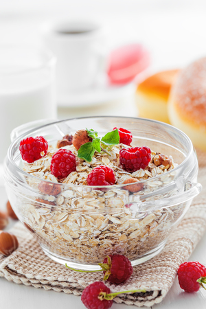 Healthy food breakfast. Oatmeal muesli with fruits and nuts, close-up.