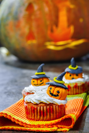 sweet course: Halloween cupcake with pumpkins in hat, Jack O