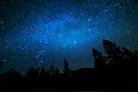 Milky Way in sky full of stars. Winter mountain landscape in night. Stock Photo
