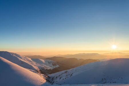 evening glow: Sunset landscape. Evening glow in winter mountains.
