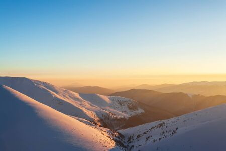evening glow: Evening glow in winter mountains. Stock Photo