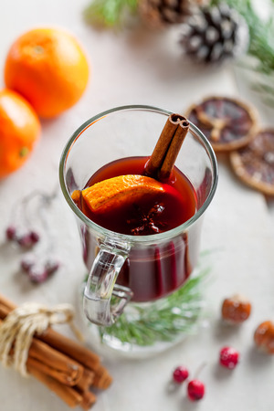 punch spice: Glass of mulled wine with citrus fruits and cinnamon. Stock Photo