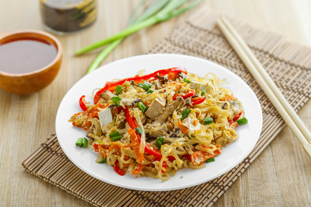 oriental cuisine: Traditional Asian meal made of rice noodles, vegetables, tofu and shiitake mushroom. Oriental cuisine food. Stock Photo