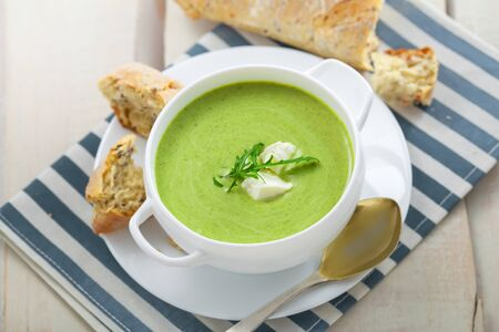 european food: Cream soup made of broccoli on table. Traditional European food. Top view. Stock Photo