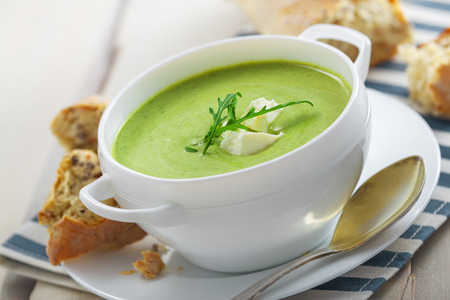 european food: Traditional cream soup made of spinach on a table. Classic European food.
