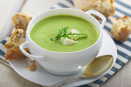 european food: Cream soup made of broccoli on table. Traditional European food.