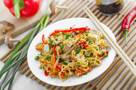 Traditional Asian meal made of rice noodles, vegetables, tofu and shiitake mushroom. Oriental cuisine food. Stock Photo