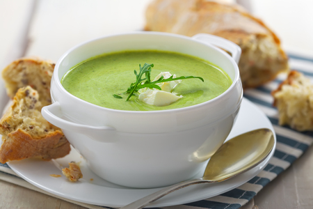 european food: Broccoli cream soup with bread on a table. Classic European food. Close-up shot. Stock Photo