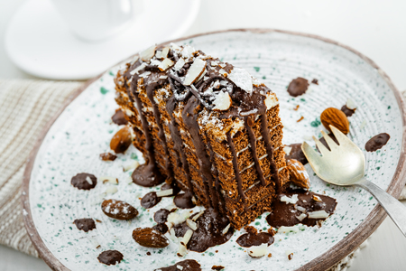 Chocolate Spartak cake for delicious dessert on a table. Traditional sweet food on a rustic plate.