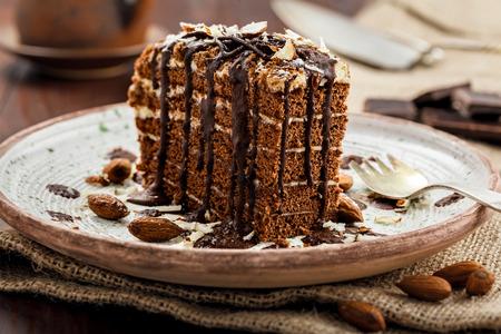 Delicious sweet chocolate Spartak cake on a rustic plate. Haute cuisine dessert. International food. Close-up shot.