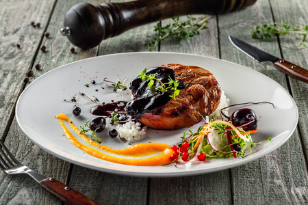 Tasty grilled steak with salad and rice. Gourmet meal made of meat and vegetables. Delicious healthy food. Stock Photo