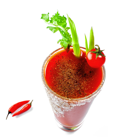 Glass of bloody mary isolated on a white background. Delicious alcohol cocktail made of tomato juice, vodka, pepper, salt, lemon juice, celery and other flavorings. Stock Photo