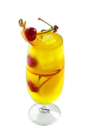 Glass of fruit cocktail drink made of fruit made of fruit juice, orange, cherry and alcohol isolated on white background.