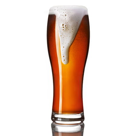 Classic draft pale ale beer in a weizen glass isolated on white background.