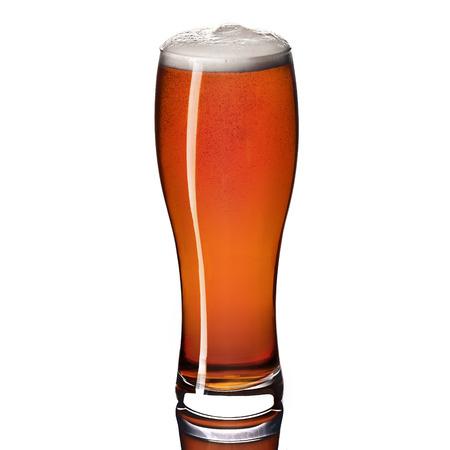 Craft dark amber ale beer in a weizen glass isolated on white background. Studio shot.