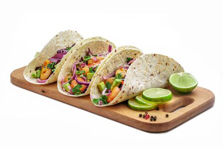Tacos with shrimps., avocado and red onion on a wooden table. Traditional American fast food. Studio shot, isolated on white background. Фото со стока